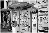 Automatic vending machines dispensing everything, including pornography. Tokyo, Japan ( black and white)