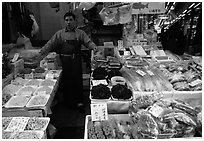 Seafood vendor in a popular street. Tokyo, Japan ( black and white)