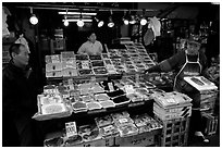 Seafood store in a popular street. Tokyo, Japan ( black and white)