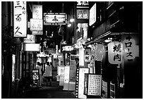 Narrow alley in the Pontocho entertainment district by night. Kyoto, Japan (black and white)
