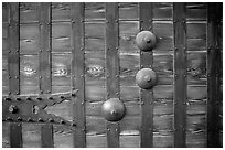 Detail of heavy wooden door. Himeji, Japan (black and white)