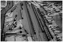 Rail tracks and cargo cars in winter. Calgary, Alberta, Canada ( black and white)
