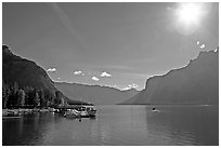Lake Minnewanka (only lake in the Park that allows motorized boats) and marina, morning.. Banff National Park, Canadian Rockies, Alberta, Canada (black and white)