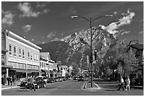 Banff Avenue and Cascade Mountain, mid-morning. Banff National Park, Canadian Rockies, Alberta, Canada (black and white)