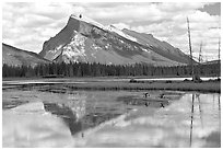 Canoe and Mt Rundle reflection in first Vermillion Lake, afternon. Banff National Park, Canadian Rockies, Alberta, Canada ( black and white)