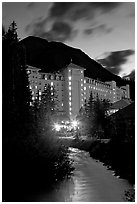 Chateau Lake Louise and stream at night. Banff National Park, Canadian Rockies, Alberta, Canada ( black and white)