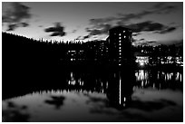 Chateau Lake Louise Hotel reflected in Lake at night. Banff National Park, Canadian Rockies, Alberta, Canada (black and white)