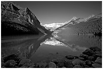 Mountains reflected in Lake Louise, early morning. Banff National Park, Canadian Rockies, Alberta, Canada ( black and white)