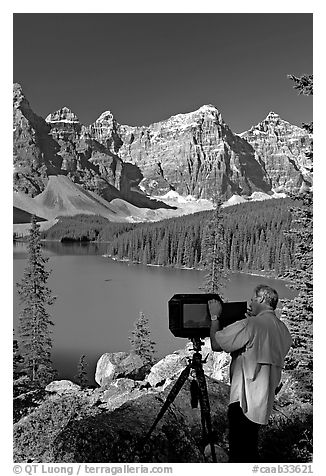 Black and white picture photo photographer operating a 8x10 view camera at moraine lake banff national park canadian rockies alberta canada