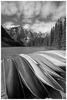 Colorful canoes stacked on the boat dock, Lake Moraine, morning. Banff National Park, Canadian Rockies, Alberta, Canada (black and white)