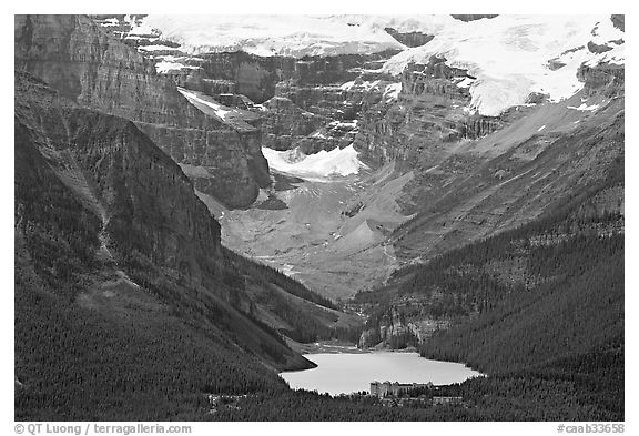Distant view of Lake Louise and Chateau Lake Louise at the base of Victorial Peak. Banff National Park, Canadian Rockies, Alberta, Canada (black and white)