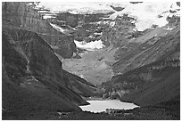 Distant view of Lake Louise and Chateau Lake Louise at the base of Victorial Peak. Banff National Park, Canadian Rockies, Alberta, Canada ( black and white)