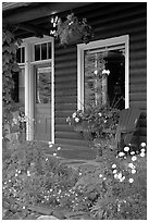 Flowered porch of a wooden cabin. Banff National Park, Canadian Rockies, Alberta, Canada (black and white)