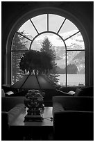 Lake Louise seen through a window of Chateau Lake Louise hotel. Banff National Park, Canadian Rockies, Alberta, Canada (black and white)