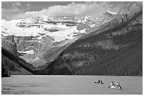 Canoes, Victoria Peak, and blue-green glacially colored Lake Louise, morning. Banff National Park, Canadian Rockies, Alberta, Canada ( black and white)
