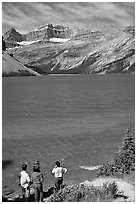 Family standing on the shores of Bow Lake. Banff National Park, Canadian Rockies, Alberta, Canada ( black and white)