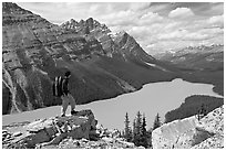 Hiker standing on a rock overlooking Peyto Lake. Banff National Park, Canadian Rockies, Alberta, Canada ( black and white)