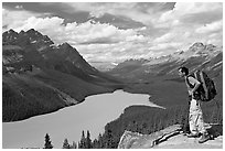 Hiker wearing backpack looking at Peyto Lake. Banff National Park, Canadian Rockies, Alberta, Canada ( black and white)