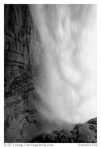Curtain of water of Panther Falls, seen from behind. Banff National Park, Canadian Rockies, Alberta, Canada (black and white)