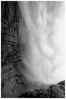 Curtain of water of Panther Falls, seen from behind. Banff National Park, Canadian Rockies, Alberta, Canada ( black and white)