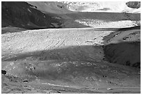 Base of Athabasca Glacier with cars parked on lot. Jasper National Park, Canadian Rockies, Alberta, Canada ( black and white)