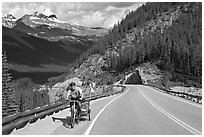Cyclist with tow, Icefieds Parkway. Jasper National Park, Canadian Rockies, Alberta, Canada (black and white)