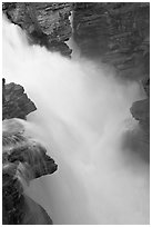 Water cascading over a glacial rock step, Athabasca Falls. Jasper National Park, Canadian Rockies, Alberta, Canada (black and white)