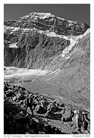 Hikers on trail below the face of Mt Edith Cavell. Jasper National Park, Canadian Rockies, Alberta, Canada (black and white)