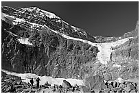 Hikers on a moraine below Mt Edith Cavell, morning. Jasper National Park, Canadian Rockies, Alberta, Canada (black and white)