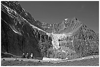 Hikers look at Angel Glacier, late morning. Jasper National Park, Canadian Rockies, Alberta, Canada ( black and white)