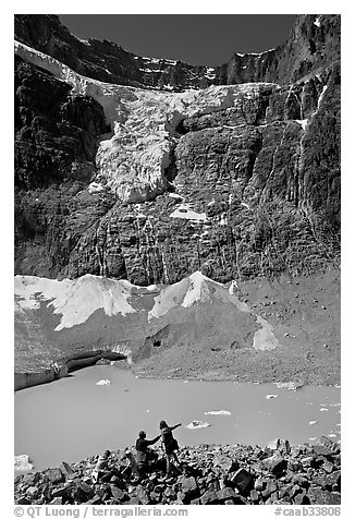 Family looking at Cavell Pond and Angel Glacier. Jasper National Park, Canadian Rockies, Alberta, Canada (black and white)