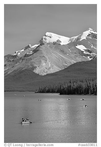 Red canoe on Maligne Lake, afternoon. Jasper National Park, Canadian Rockies, Alberta, Canada (black and white)