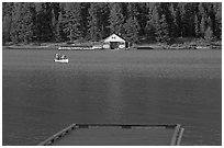 Dock, canoe, and boathouse, Maligne Lake. Jasper National Park, Canadian Rockies, Alberta, Canada (black and white)