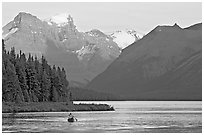 Canoist paddling on Maligne Lake at sunset. Jasper National Park, Canadian Rockies, Alberta, Canada (black and white)