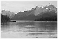 Peaks reflected in rippled water, Maligne Lake, sunset. Jasper National Park, Canadian Rockies, Alberta, Canada (black and white)