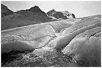 Glacial stream at the toe of Athabasca Glacier. Jasper National Park, Canadian Rockies, Alberta, Canada ( black and white)
