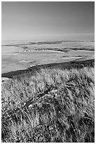 Prairie and teepees from the top of the cliff, Head-Smashed-In Buffalo Jump. Alberta, Canada (black and white)
