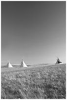 Teepee tents and prairie, late afternoon, Head-Smashed-In Buffalo Jump. Alberta, Canada (black and white)