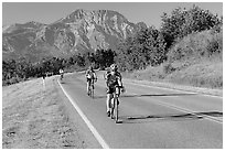 Cyclists on road. Waterton Lakes National Park, Alberta, Canada (black and white)