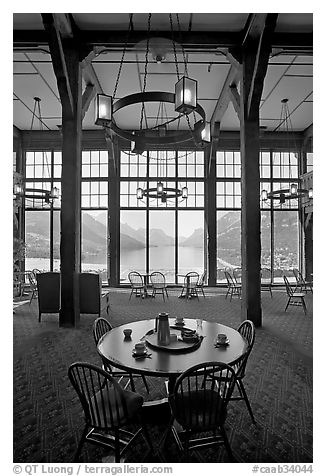 Table in lobby of Prince of Wales hotel with view over Waterton Lake. Waterton Lakes National Park, Alberta, Canada (black and white)