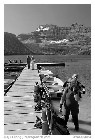 Couple preparing to scuba dive, Cameron Lake. Waterton Lakes National Park, Alberta, Canada (black and white)