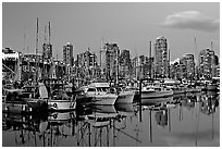 Small boat harbor and skyline at dusk. Vancouver, British Columbia, Canada (black and white)
