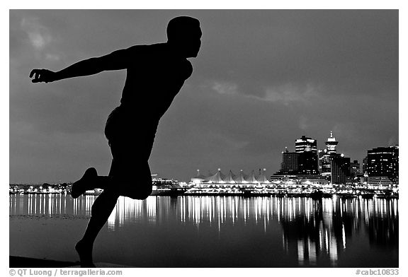 Harry Jerome (a former great sprinter)  statue and Harbor at night. Vancouver, British Columbia, Canada (black and white)