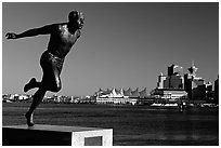 Runner's statue and Harbor center, late afernoon. Vancouver, British Columbia, Canada ( black and white)