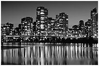 High-rise buildings reflected in False Creek at night. Vancouver, British Columbia, Canada (black and white)
