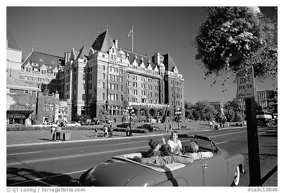 Red convertible car and Empress hotel. Victoria, British Columbia, Canada