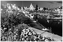 Flowers, inner harbour, and lights at night. Victoria, British Columbia, Canada (black and white)