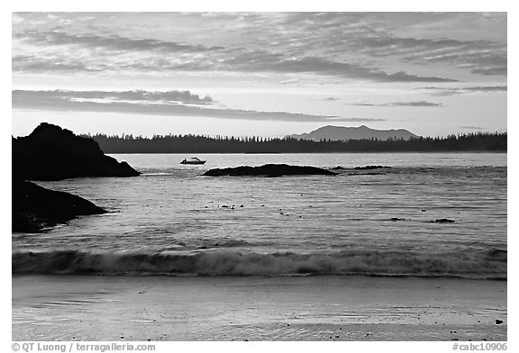 Marine landscape with a small boat in a distance, sunset. Pacific Rim National Park, Vancouver Island, British Columbia, Canada (black and white)