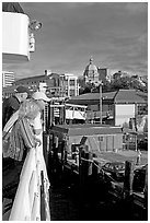 Passengers standing on the deck of the ferry, as it sails into the Inner Harbor. Victoria, British Columbia, Canada ( black and white)
