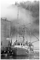 Commercial fishing boat and fog, Tofino. Vancouver Island, British Columbia, Canada (black and white)